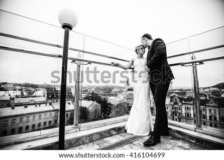 young groom is enjoying his beautiful wife - stock photo