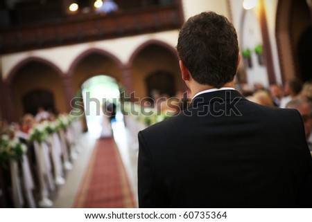 Young groom is waiting for a bride - stock photo