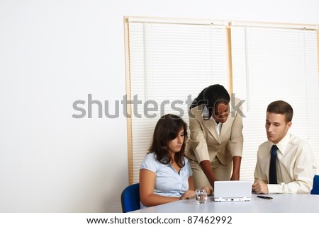 Young group of business people working with a laptop. - stock photo