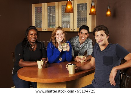 Young Group of Friends at the Cafe - stock photo