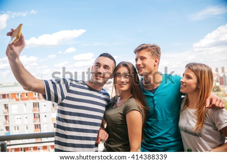 Young Group Of Friends Doing A Selfie On A Balcony