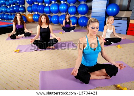 young group of girls exercising yoga in lotus flower position - stock photo