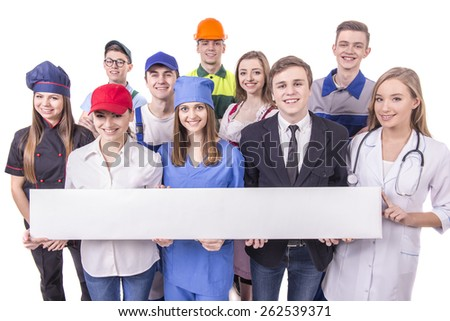 Young group of industrial workers. Isolated on white background. White table with empty space for the text. - stock photo