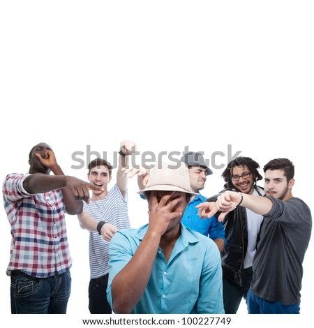 Young group of men who are bullying one of them. - stock photo