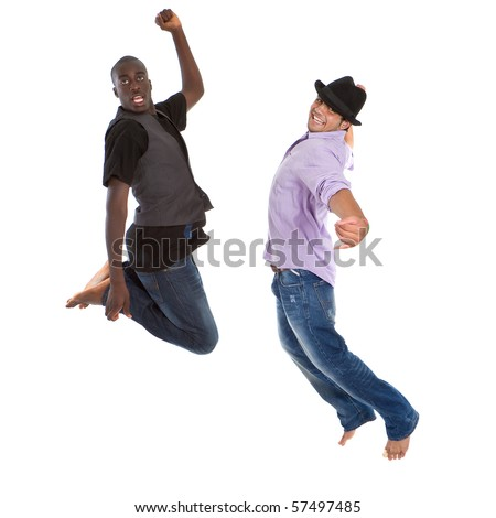 Young group of teenagers with trendy clothes jumping in joy over white background. - stock photo