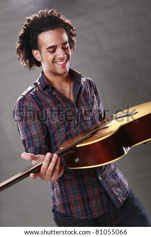 Young guitar player - stock photo