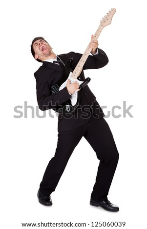 Young guitar player dressed in black and singing - stock photo