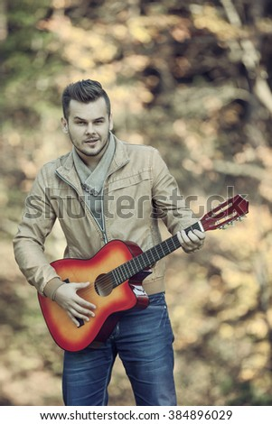 young guitarist - stock photo