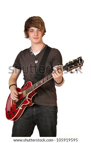 Young guitarist playing guitar, isolated on white
