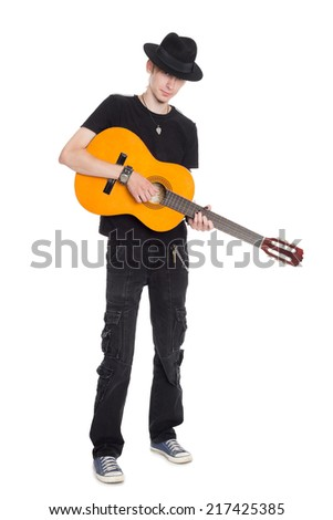 Young guitarist playing isolated on white background.