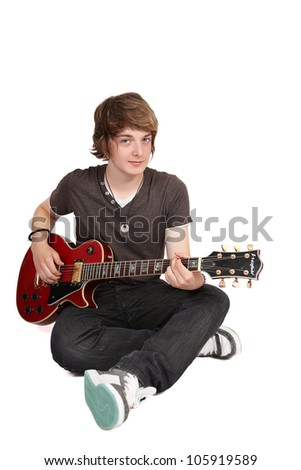 Young guitarist sitting crossed legs, isolated on white - stock photo
