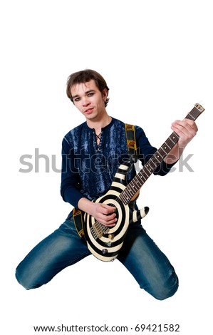 Young guitarist with electric guitar on white background