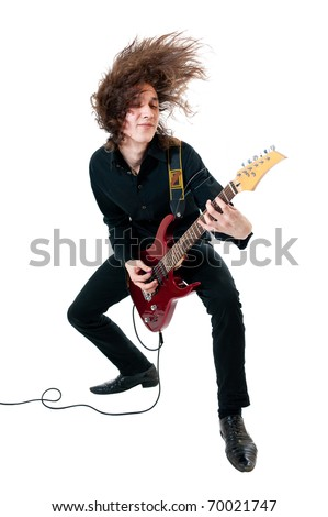 Young guitarist with red guitar on white background - stock photo