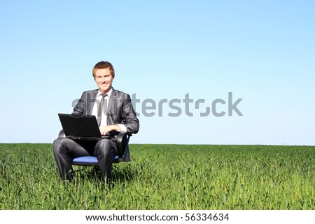 Young guy businessman. In the suit, on the field