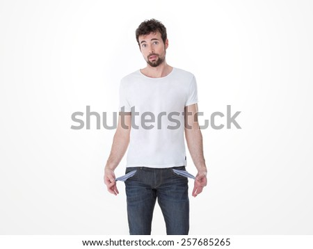 young guy exhibiting his empty pockets - stock photo