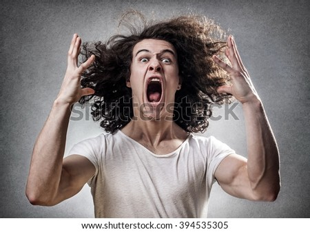 Young guy facing a mental collapse with a desperate expression - stock photo