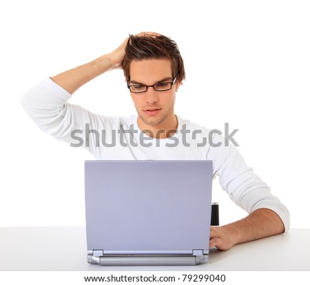 Young guy got a problem with his computer. All on white background. - stock photo