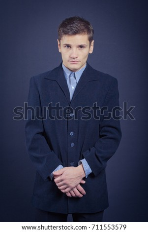 young guy in a business suit posing in Studio. Wallpapers for your desktop. emotional portrait. male businessman. problem skin and short hair