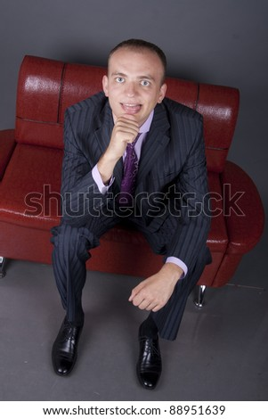 young guy in a suit waiting for their turn to be interviewed - stock photo