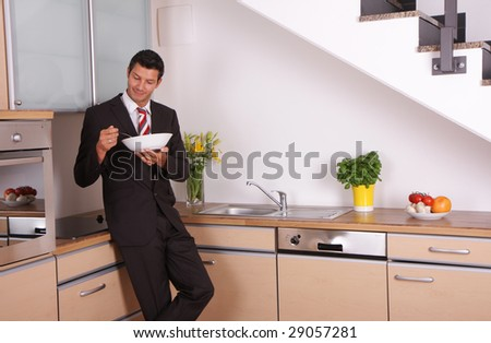Young guy in black clothes indoors - stock photo
