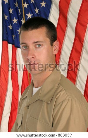young guy in front of American flag