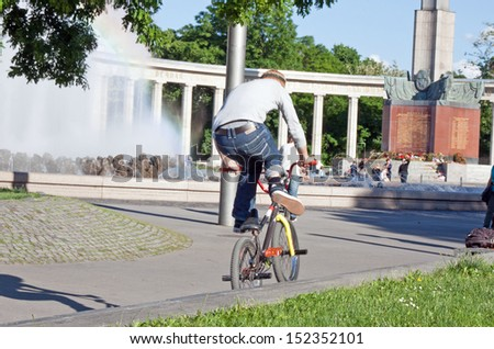 Young guy is riding a bmx bike - stock photo