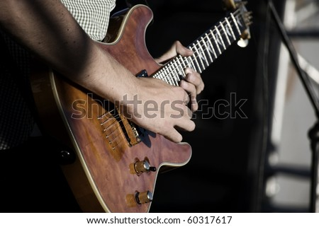 Young guy performing live at the concert - stock photo