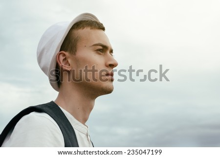 young guy photographer hipster outdoors look in distance - stock photo
