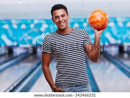 Young guy playing in bowling