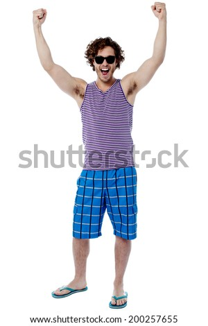 Young guy raising his hand in excitement - stock photo