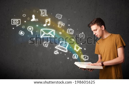 Young guy reading a book with multimedia icons coming out of the book - stock photo