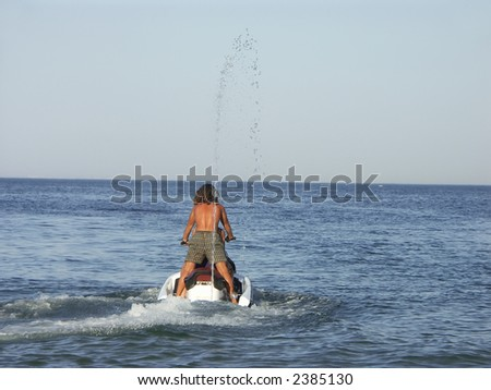 Young guy riding a jet ski