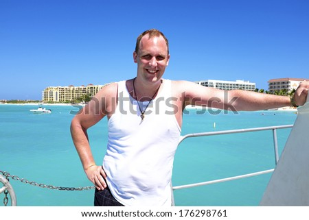 Young guy sailing in the caribic - stock photo