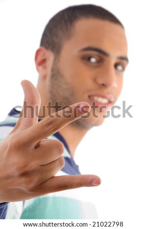 young guy showing rock hand gesture with white background - stock photo