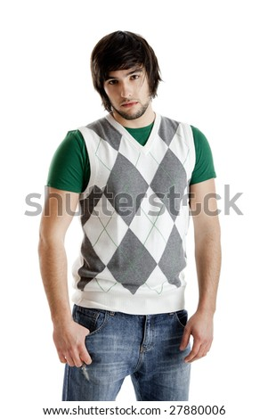 Young guy standing against a white background - stock photo