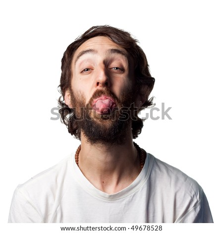 Young guy sticks out his tongue to camera
