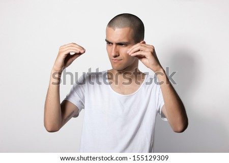 young guy talking with gestures, depicts dialogue - stock photo