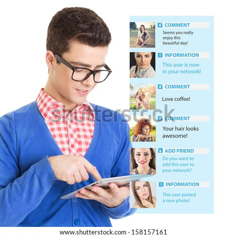Young guy using social network on tablet computer