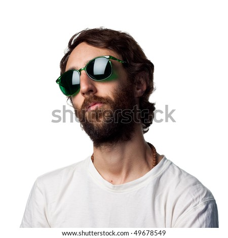 Young guy wearing green glasses - stock photo