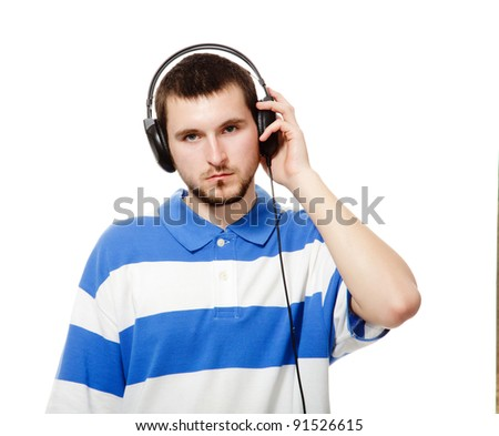 young guy with a beard, listening to music on headphones, isolated on a white background. - stock photo