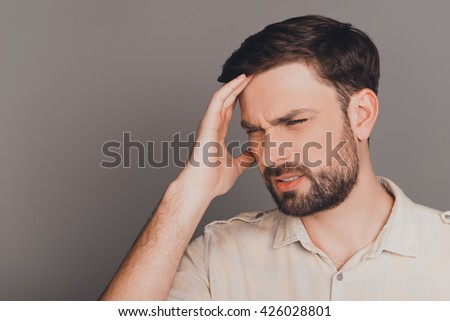 Young guy with big problems having strong headache - stock photo