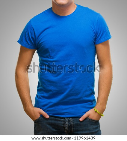 Young Guy With Blue Shirt On Grey Background