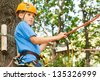 Young guy with climber equipment focused  for moving. - stock photo