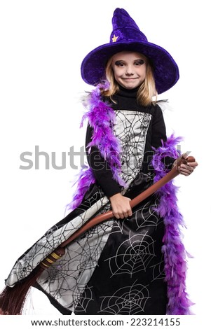 Young Halloween witch with a broom. Studio portrait isolated over white background - stock photo