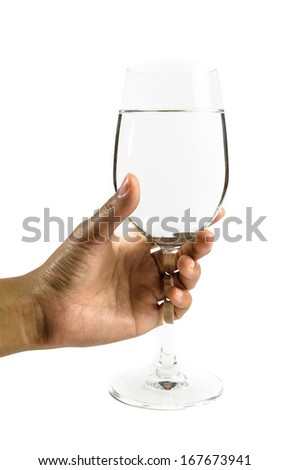 young hand girl hold single wine glass with bright light isolated on white backgrounds