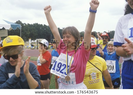 Young Handicapped athlete celebrating during Special Olympics, UCLA, CA - stock photo