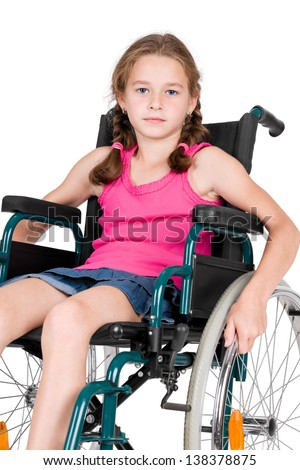 Young handicapped girl in a wheelchair over white background.