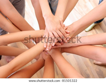 Young hands on top of each other - stock photo