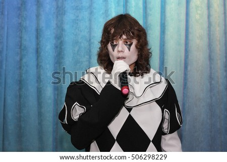 young handsome actor playing the role of Pierrot