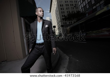 Young handsome African American businessman in the city at night